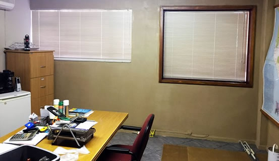 Here is the office after installation of Venetian Office blinds. The blinds blocks out the direct sunlight and insures privacy for this office worker.
